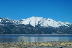Washoe Lake is full currently with a much healthier snowpack in the nearby Carson Range. Slide Mountain as viewed across Washoe Lake from Deadman Canyon in the State Park.